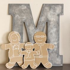 Make your family in cardboard gingerbread people, you can customize them to look like you and the end result is so cute!