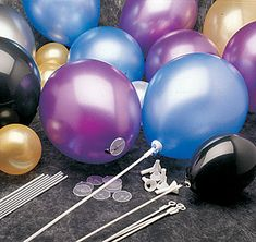 Balloon Sticks help you create beautiful balloon centerpieces. Slip the white 23 inch sticks into plastic holders to stand balloons upright without helium.