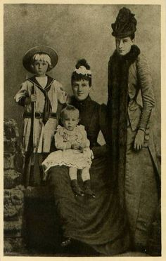 Queen Amelie of Portugal with her sons and her sister Helene d'Orleans.