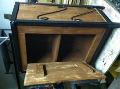 Old wood pallets used as cabinet with metal frame from old fish tank stand