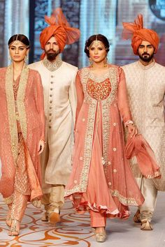 Models present creations by designer Nauman Arfeen on the third day of the Bridal Couture Week in Karachi, Pakistan, Monday, May 12, 2014.