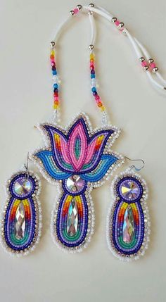 so much beauty in one picture. wish i could find someone who could make me a beautiful set like this. Native Beading Patterns, Beadwork Designs, Native Beadwork, Native American Beadwork, Native American Moccasins, Beaded Jewelry Patterns, Native American Jewelry, Indian Beadwork, Beading Projects