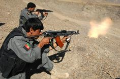 """gunrunnerhell: """" AMD-65 Afghan police officers using their Hungarian AMD-65 rifles; a very distinct AK variant. Note the one in the foreground. Very interesting that he put on a slant-style muzzle brake. Talk about muzzle flash. Also note that both..."""