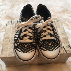 Coach Black and White Sneakers Fun Coach sneakers that dress up jeans! There's a patent leather stop on the back as shown in picture! Great clean condition Coach Shoes Sneakers