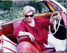 Charlotte Moss. Southern sass and class.  Check the teak trim, white steering wheel, that blouse... jones.