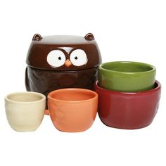 Artfully hand-painted, this set of earthenware measuring cups adds whimsical appeal with an owl motif.   Product: 5 Measuring cu...