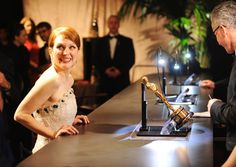 """Oscars 2015: Governors Ball Julianne Moore has her Oscar engraved. """"Still Alice"""""""