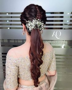 Bridesmaids can use these pretty blooms to glam up their sleep pony hairstyles too. - Education and lifestyle Bridal Hairstyle Indian Wedding, Bridal Hair Buns, Bridal Braids, Bridal Hairdo, Indian Wedding Hairstyles, Bridal Hair And Makeup, Elegant Hairstyles, Pony Hairstyles, Bride Hairstyles