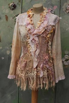 Whimsy vintage cotton blouse/jacket, altered couture; reworked with intricate details to discover. The hems are draped with antique and vintage cotton laces, vintage metallic embroideed silk trims, small hand dyed cotton jersey ruffles. Adorned with hand sculpted roses, crystals and