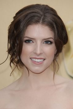 Anna Kendrick wearing a messy elegant updo hairstyle while attending the 82nd Annual Academy Awards