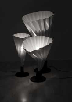 """the Rhubarb series of lamps made of folded polypropylene. French-born and Sweden-based designer, Emma Marga Blanche, likens it to an 'elegant """"rhubarb"""" that grows directly out of earth'."""