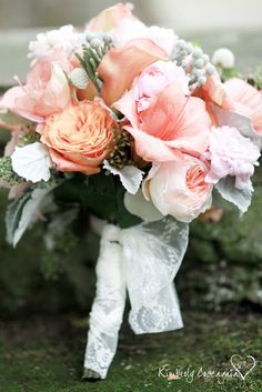 Lovely bouquet consisting of pink Amaryllis blush and peach Garden Roses, and Dusty Miller.
