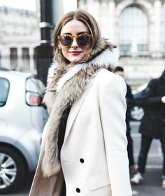 This is an image of Olivia Palermo at Paris Fashion Week in the last yew years. She is wearing a fur shall today that represents a style shows to us back in the Paired with a pea coat of the time making this a modern day outfit, resembling a old trend. Estilo Olivia Palermo, Olivia Palermo Lookbook, Olivia Palermo Style, Fashion Mode, Look Fashion, Street Fashion, Fashion Trends, Paris Fashion, Net Fashion