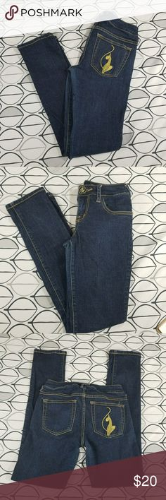"""Baby Phat Dark Blue Skinny Jeans size 3 Baby Phat Jeans in excellent condition skinny jeans dark wash with the Baby Phat Cat Logo on one of the back pockets. Size 3 but listing as a 2 (runs small) please check measurements laying flat are approximate waist 13"""" inseam 29""""rise 8"""" Baby Phat Jeans Skinny"""