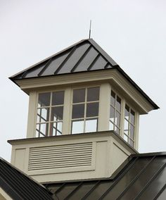 Cupolas - Square venting cupola with windows and standing seam roof. - Glass cupolas do include some venting at the base to prevent moisture build up and to provide some air exchange.