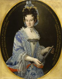 """Portrait of the Marchioness Angela Maria Lombardi ~ ca.1710 ~ Angela Maria Lercari was born in Genoa in 1684 and married Marquis Anton Filippo Lombardi in 1704.The marchioness wears a splendid costume that enhances her beauty and marks her social status. Her """"mantua"""" (a one-piece open robe) is made of a sky-blue silk damask brocaded in silver and trimmed in the finest lace. The so-called """"bizarre"""" pattern of the damask, produced in France and Italy, was highly fashionable around 1700."""