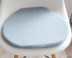 Seat cushion for Eames Chair in light grey cuddly fur Eames, Dark Grey Background, Seat Pads, Seat Cushions, Creative, Etsy, Chair, Fur, Handmade Gifts