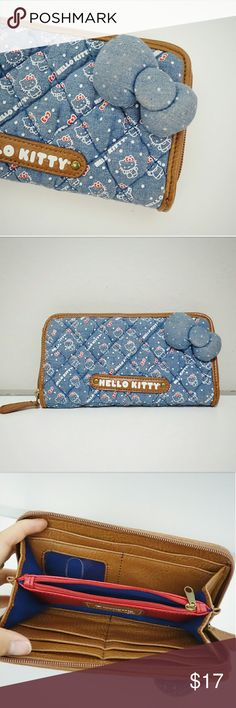 "Loungefly Hello Kitty Denim Quilted Long Wallet Loungefly Hello Kitty denim quilted long wallet with faux leather lining :) The blue, brown and red matches so well together ?Has seven card slots and one ID card slot and one large bill slot on the side. Approx. 8"" L x 4.25"" W x 1.25"" D (without bow). Gently used, in excellent condition. Purchased for $30. Only the bow in the front is slightly dirty (see pic) but everything else is like new.   Tags: cute kawaii sanrio sanx Japan lolita…"