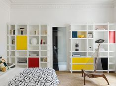 custom storage unit inspired by Mondrian's New York City series; ceramics by Sophie Dries and Ettore Sottsass; 'Harp' chair by Jorgen Hovelskov edited by PP Møbler.