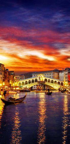 Ponte Rialto and gondola at sunset in Venice, Italy