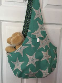 Another new dog sling pattern is ready to go! Holds dogs up to 12lbs. Reversible and machine washable. Features dog tether and handy pocket
