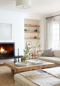 Neutral living room with modern furniture on Thou Swell @thouswellblog