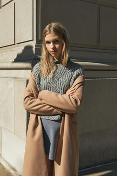 Her new tribe tumblr. Layered fabrics in grey and camel. Flannel skirt, knitted sweater, and soft coat