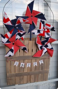Patriotic fabric pinwheels in a paint stick picket fence