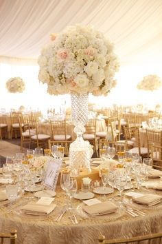 Elegant Glass Centerpiece Topped with White Roses & Hydrangeas | Photography: Amanda Sudimack for Artisan Events. Read More: http://www.insideweddings.com/weddings/a-fairy-tale-wedding-fit-for-former-miss-illinois/569/