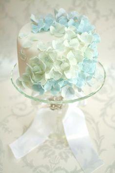 White fondant with pastel blue hydrangea flower pedals