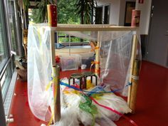 Built a simple wood framed cube-children decorate it and make it their own -educational somersault