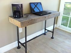New Desk Ideas - Weathered reclaimed barnwood desk, modern industrial style featuring steel pipe legs.. $675.00, via Etsy.