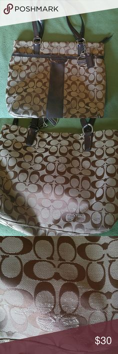 "Coach handbag Used Coach shoulder bag. Has some wear.Third picture shows worn. Fourth picture shows where straps are worn. Very clean on inside. Large outside, open pocket. Inside has two slip pockets and one zipper pocket. Measures 13 1/2""w x 10"" h. Coach Bags Shoulder Bags"
