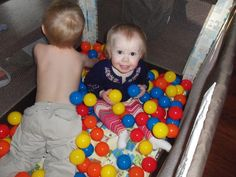 All you need is a play yard and some plastuc play balls to make your own toddler ball pit!