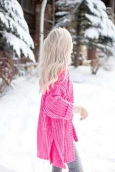 I like the bright pink oversized sweater for a gloomy winter day