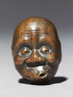 Netsuke (essentially a container) in the form of a hyottoko mask; #Japanese, 18th century