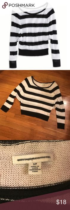 American Eagle Striped Cropped Raglan Sweater Black and white striped sweater. Has a cool, slouchy, look. Approximately 21 inches long. Sweater has some stretch. In excellent condition, no wash wear. American Eagle Outfitters Sweaters