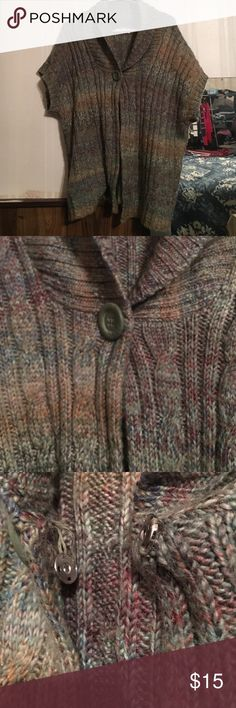 Plus size cardigan. Very warm and pretty fall colors matches well with jeans or leggings. The button in the third picture shows it is loose. Could be fixed with needle and thread. Easy fix. Open to offers Dress Barn Sweaters