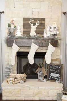 picture-of-rustic-mantel-with-pinecones-and-wood-logs-white-stockings-and-a-barnwood-sign-to-refresh-the-look