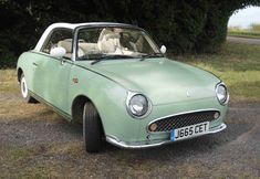 We have featured one of these before, but we are flagging up this Nissan Figaro in emerald green as it's an auction item with a starting price Nissan Figaro, Ebay Watches, Mobiles, Nissan Infiniti, Engin, Back Seat, Emerald Green, Vintage Cars, Cool Cars
