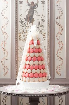 Top a Ladurée macaron pyramid with an elegant white bow- it doesn't get much more chic!