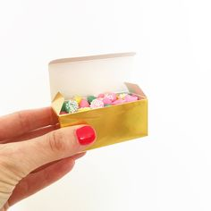 Our shiny gold candy boxes will make beautiful packaging for homemade treats, party favors, and small gifts. Pair with our gorgeous grosgrain ribbon for a truly lovely presentation. Boxes measure 2-5/