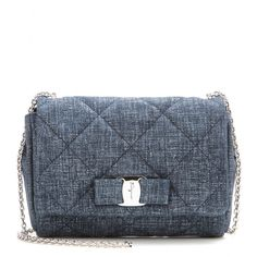 Salvatore Ferragamo - Quilted denim shoulder bag - Salvatore Ferragamo updates the signature 'Gelly' bag in a soft denim blue with subtle silver highlights. Finished off with the charming logo bow to the front, this is the perfect plus-one to printed dresses, or even your go-to jeans for a double denim moment. seen @ www.mytheresa.com