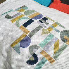 Cross stitch alphabet sampler by Caterpillar Cross Stitch in Rhythm and Blues colour palette in DMC threads.