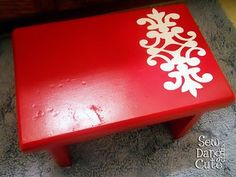Use a stencil, contact paper, or scrapbook paper for a DIY footstool.  I also saw a footstool in a magazine that I loved using squares of different scrapbook paper modge podged geometrically, but can't find it to pin it!