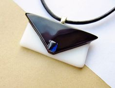 Fused Glass Jewelry - Glass Purse Necklace - Black and White with Iridescent Blue Clasp Fused Dichroic Glass Necklace. $22.00, via Etsy.