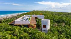 This concrete house in Mexico's tropical Yucatan Peninsula is designed by Mexico City architecture studio Productora. Called Casa Bautista, the two-storey home is nestled into a lush forest in Sian Ka'an biosphere reserve, which is about an hour drive from Tulum. Riviera Maya, Architecture Design, Residential Architecture, Amazing Architecture, House Cast, Beachfront House, Concrete Structure, Quintana Roo, Storey Homes
