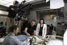"""Hugh Laurie, Jesse Spencer, Odette Annable and Rachel Eggleston behind the scenes of the """"The C-Word"""" episode of HOUSE."""