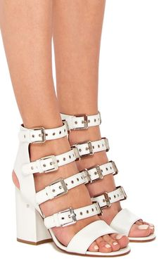 The Parisian footwear prodigy and the designer behind Chanel's footwear collection, is a master of feminine edge. These **Laurence Dacade** shoes feature a multiple buckle design for a rock 'n' roll take on the gladiator sandal.