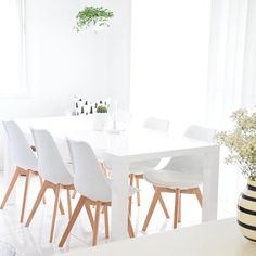 Less is more | Love the chairs and combo of crisp white, wood and greenery